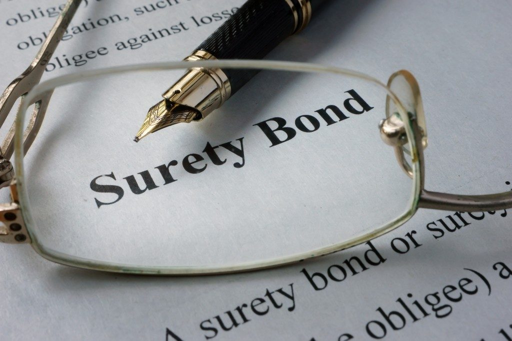 Surety bond paper with pen