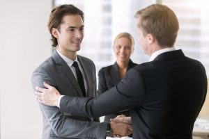 Manager congratulating his associate