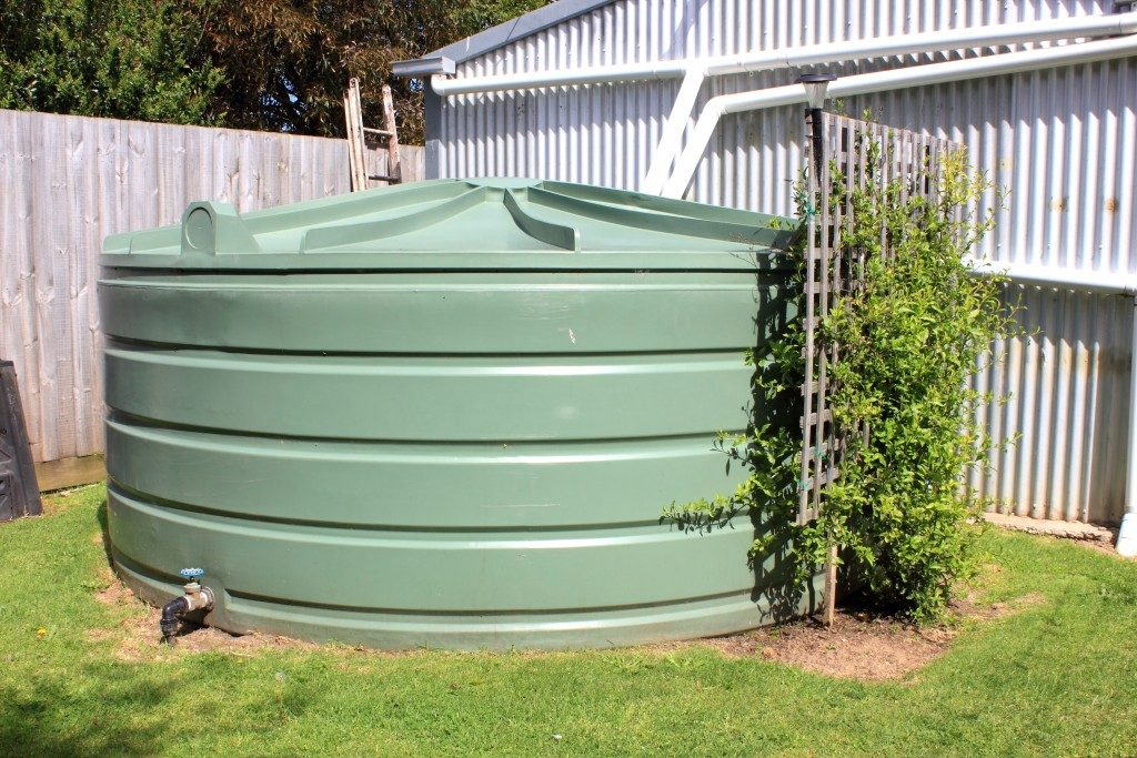 Large rainwater tank with fence