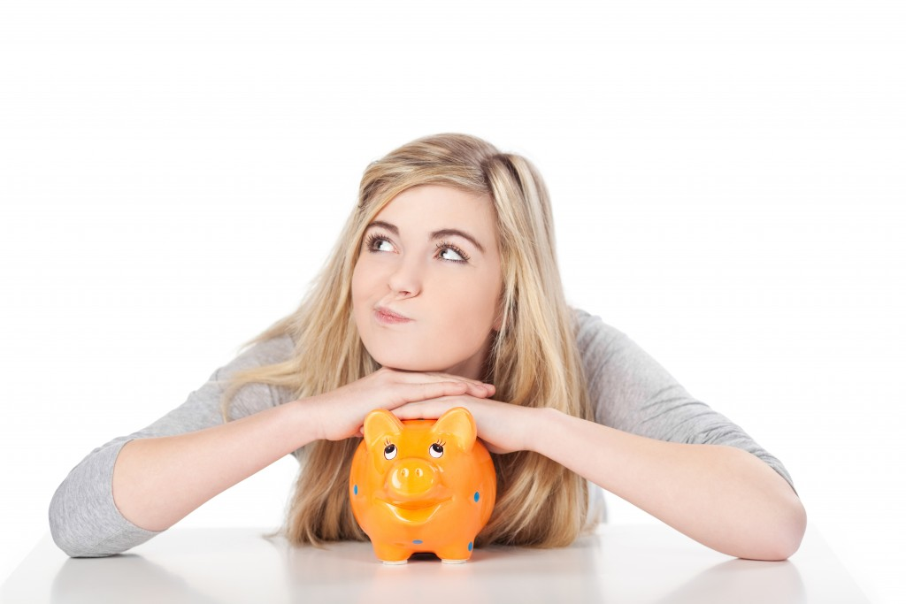 Woman on her piggy bank