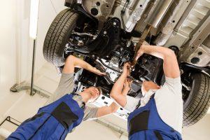 men fixing car engine