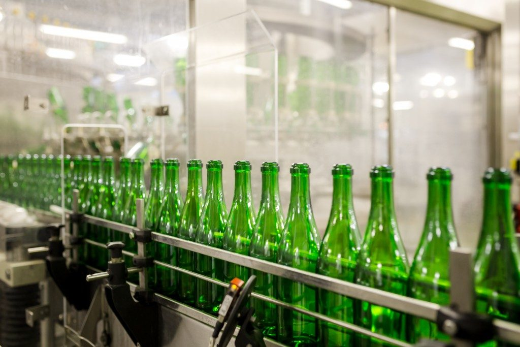 green bottles at a machine