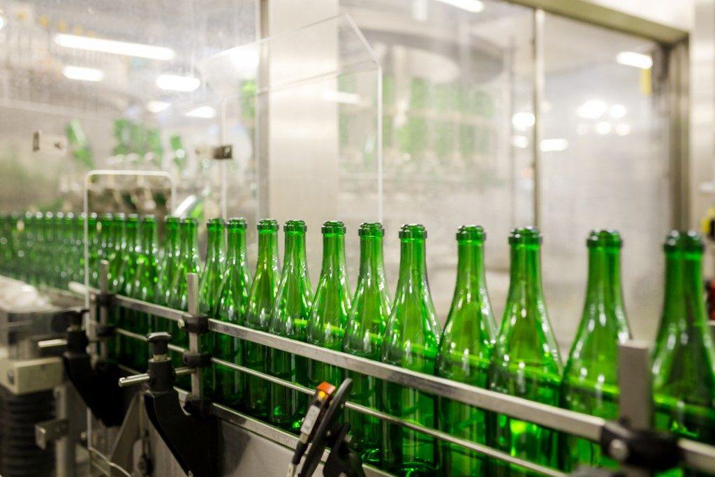 green bottles at a machine