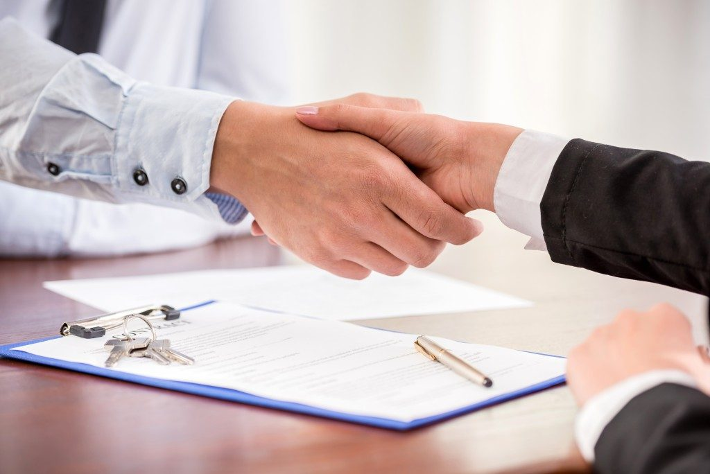 handshake of a owner and client
