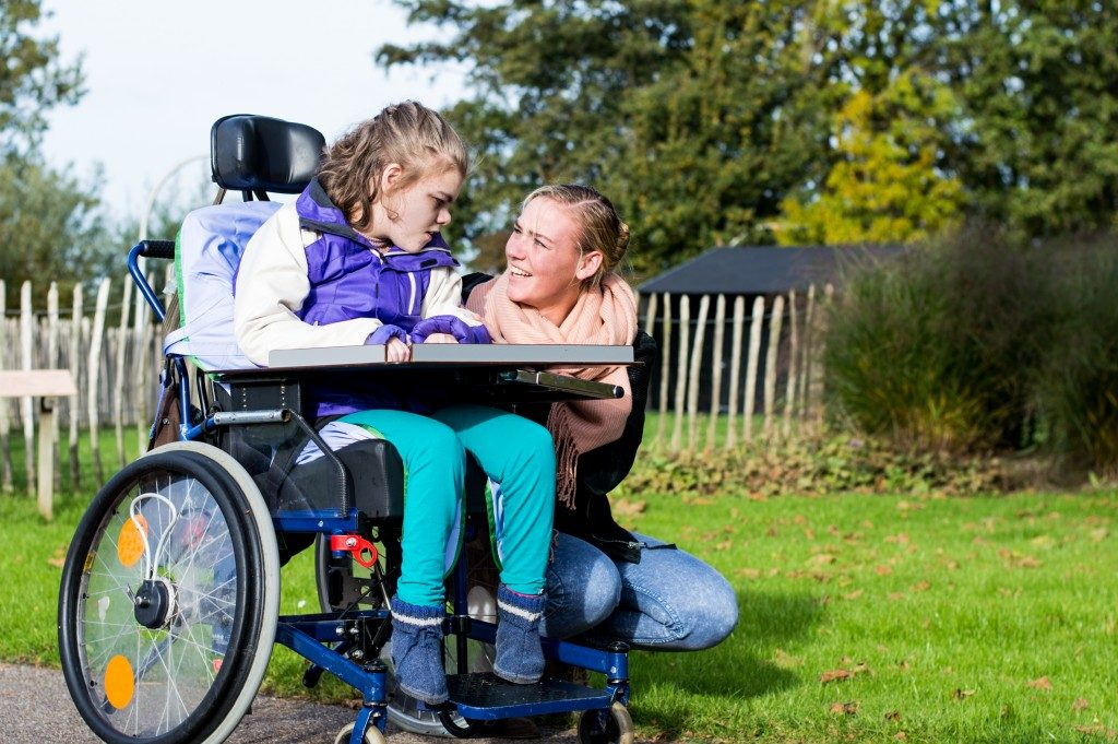 mother accompanying daughter in a wheelchair