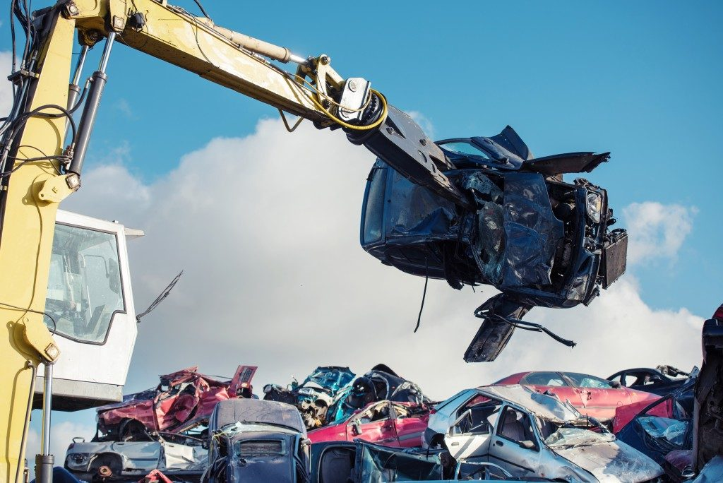 cars being shred for recycling in the site