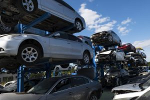 cars being piled for recycling