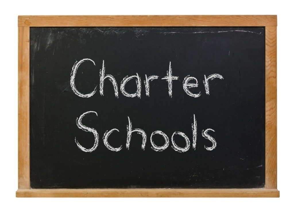 charter schools written on blackboard