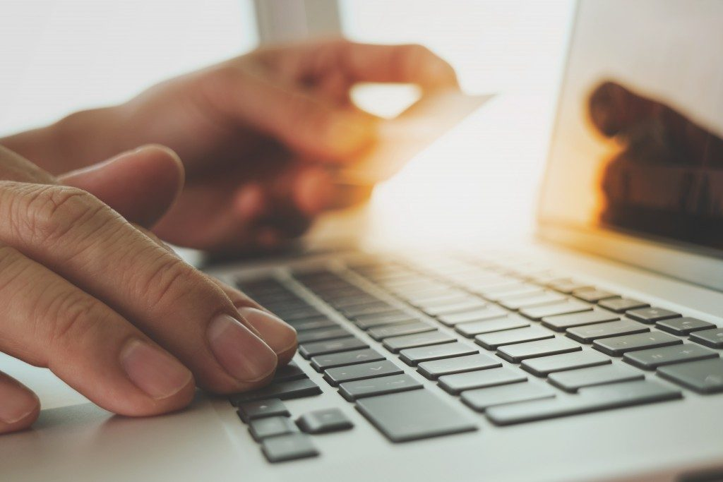 Holding credit card while typing laptop