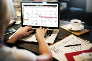 Woman managing calendar in the laptop