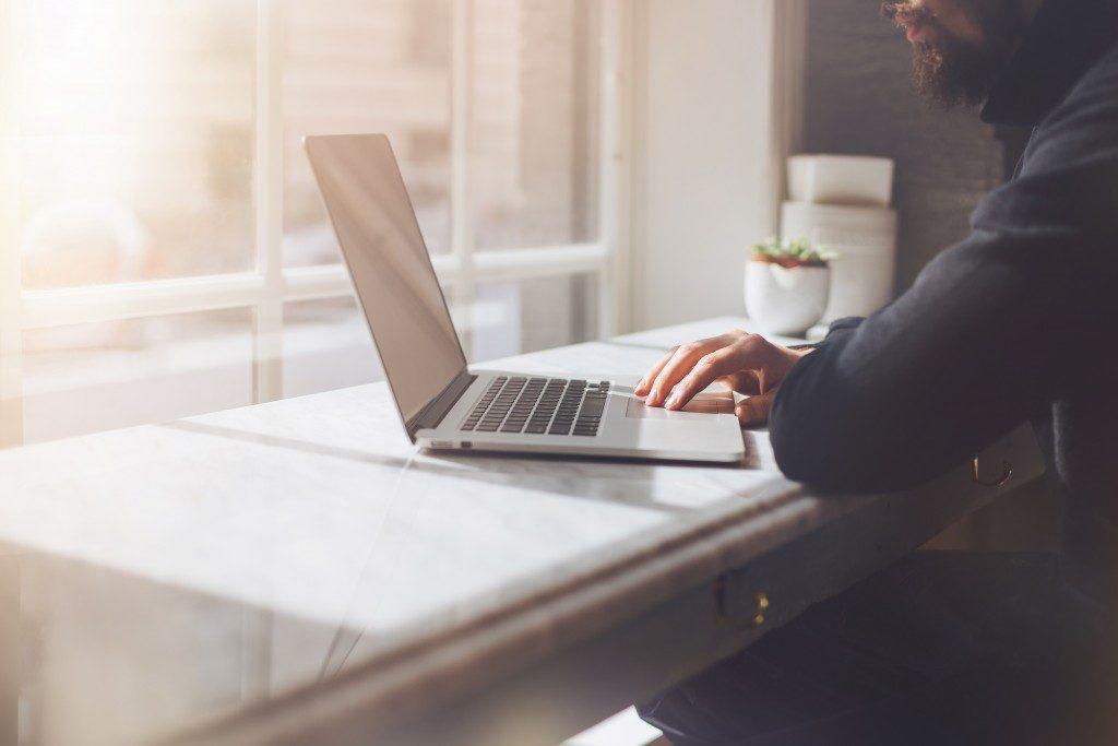 man using laptop for work
