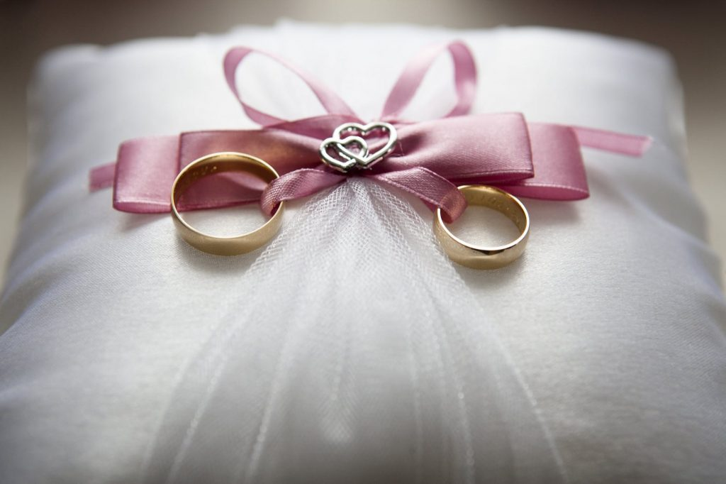 wedding rings on pillow