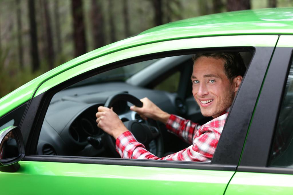 Man inside his green car