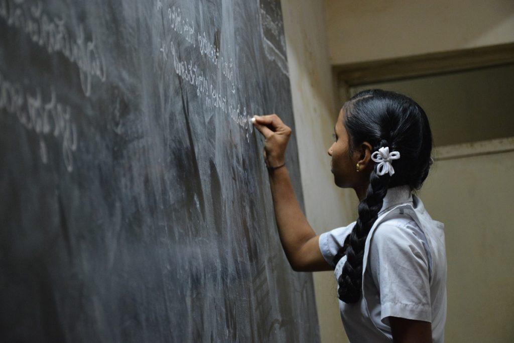 Writing on the blackboard