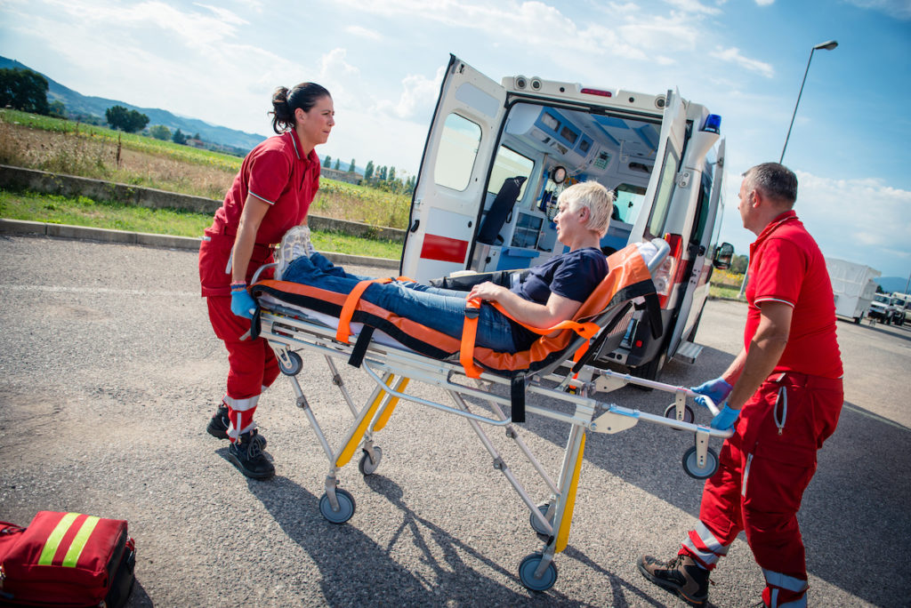 man being placed into the ambulance