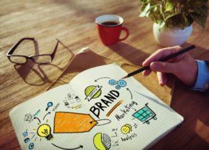 Businessman Writing Planning Marketing Brand Concept