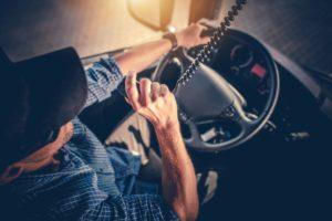 truck driver talking on cb radio