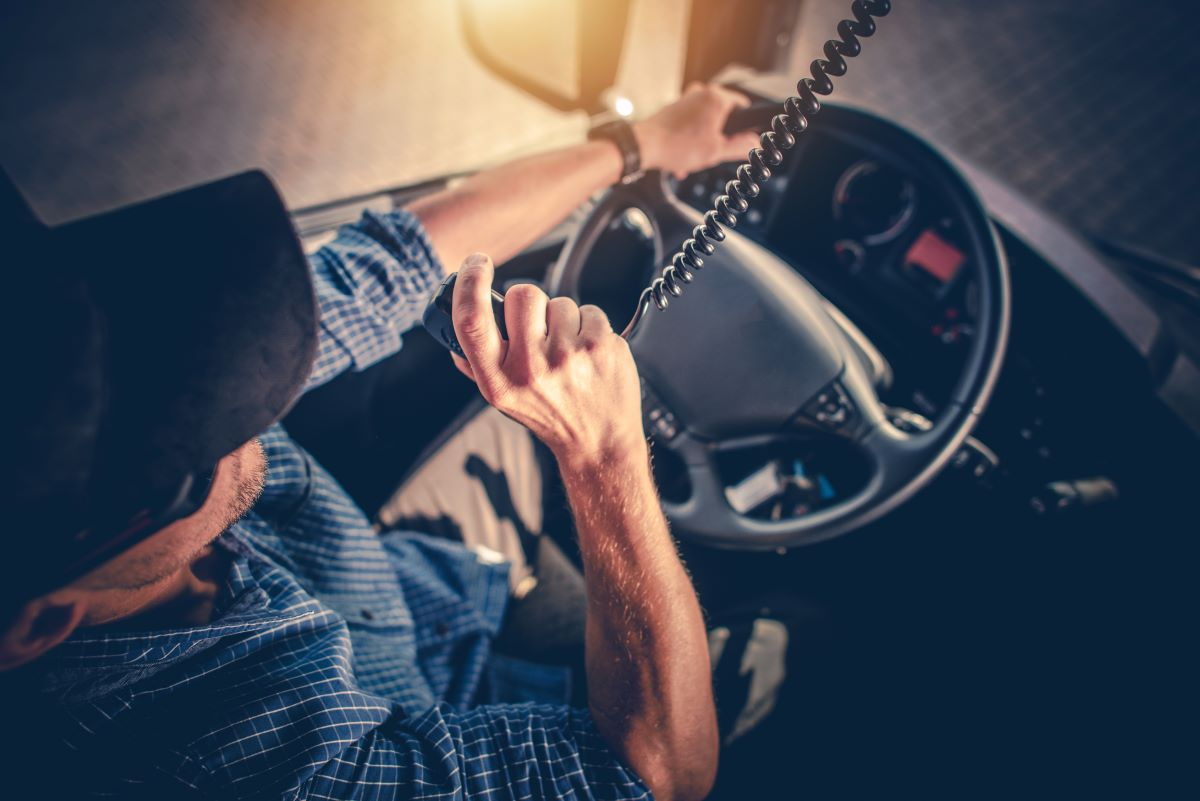 truck driver talking on cb radio