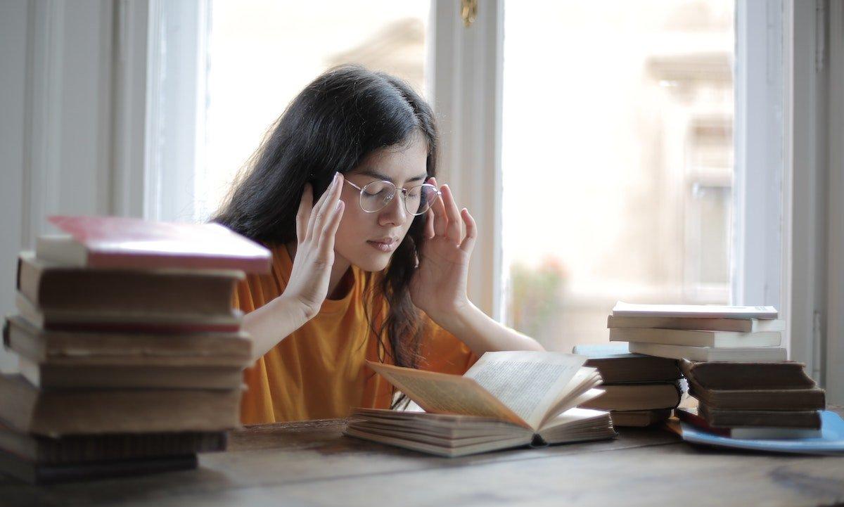 woman focusing on her studies