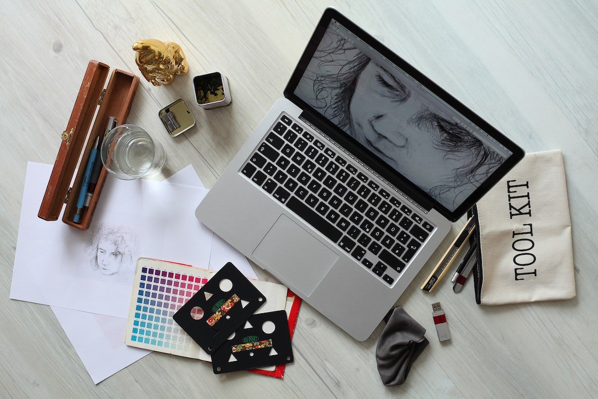 laptop and art materials