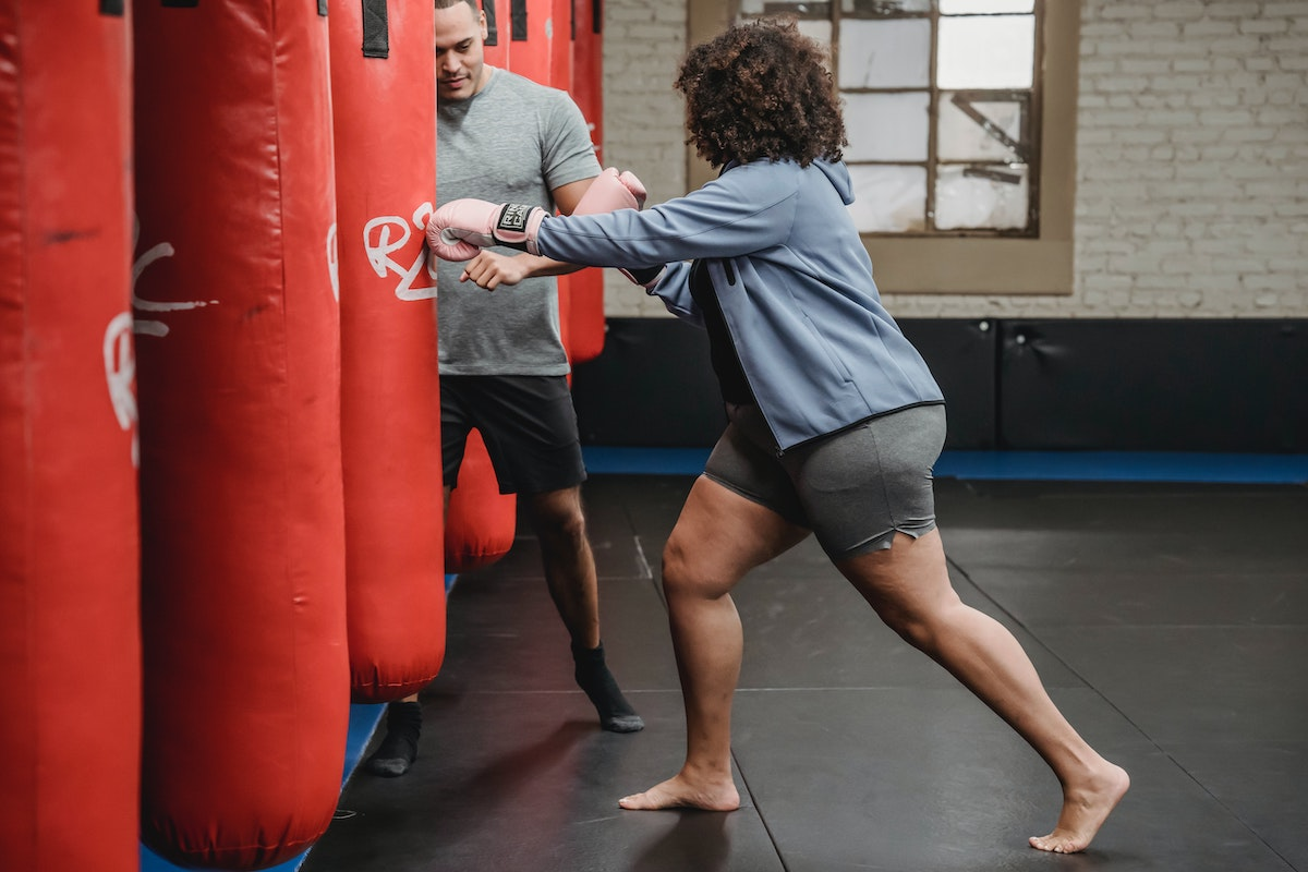 woman training with a coach